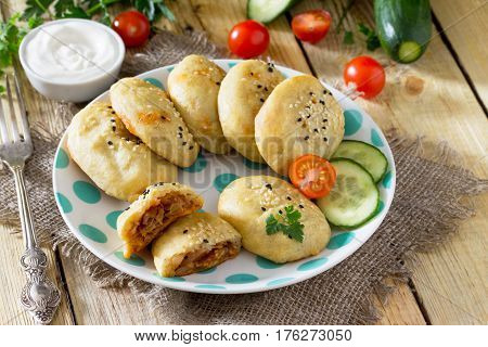 Potato Zrazy. Baked Pies From Potato Dough With Cabbage Are Served With Sour Cream Sauce, A Recipe F
