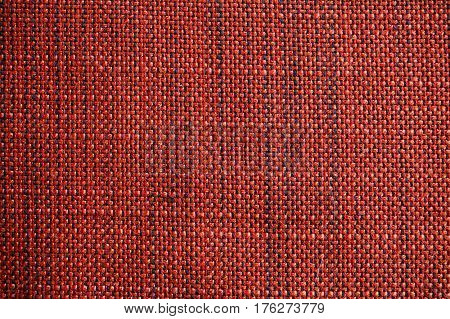 Red and orange fabric texture. Red and orange cloth background. Close up view of multicolor fabric texture and background. Abstract background and texture for designers. Cloth and fabric texture.