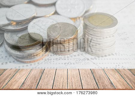 Double exposure of money coins stack for finance and banking concept Empty wood table top perspective wood can be used for display products.