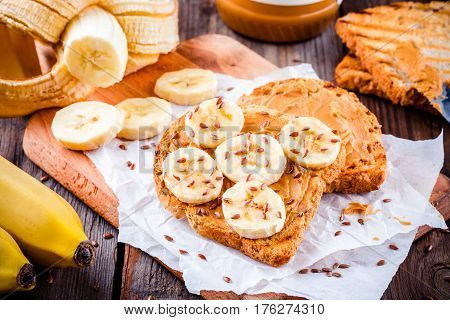 Peanut Butter Toast With Banana Slices And Flax Seeds