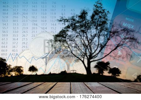 Double exposure of money coins for finance and banking concept Empty wood table top on blurred images black tree silhouettes for background.