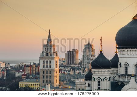 South-Eastern Railway administration building in Voronezh, symbol of city, at background of cityscape view at sunset time, rooftop view poster