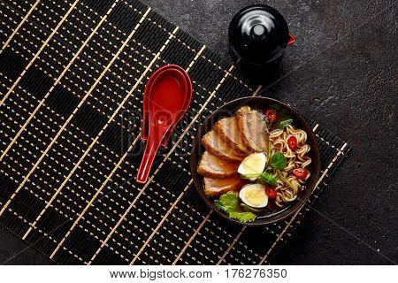 Ramen Soup With Duck Meat Over Dark Concrete Background