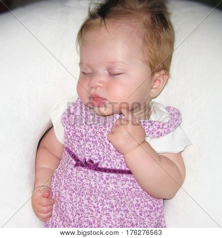baby girl sleeping hand face child blonde