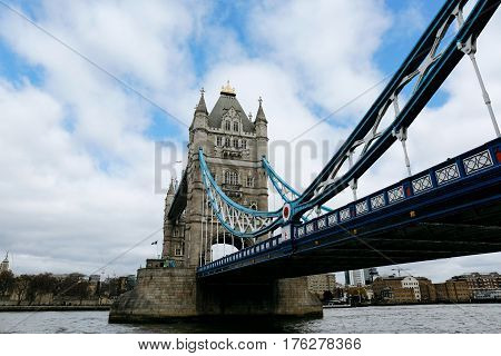 LONDON, UK - MARCH 20, 2016: Tower Bridge on a clear sunny day. Tower Bridge is often mistaken for London Bridge, the next bridge upstream.