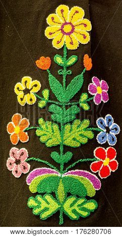 Hand embroidery in the form of colorful flowers on a woman's skirt. Traditional crafts of Bulgaria Eastern Europe