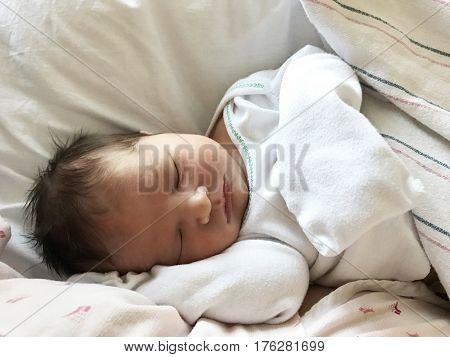 newborn baby sleeping sheets hospital girl asleep sleep