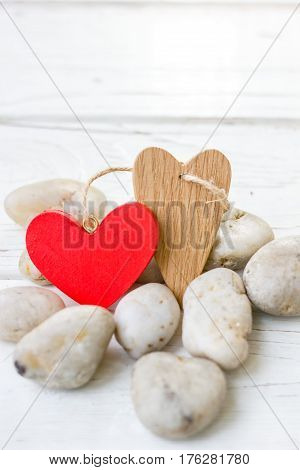 Valentine's Day Hearts On Rocks And Wood Background.