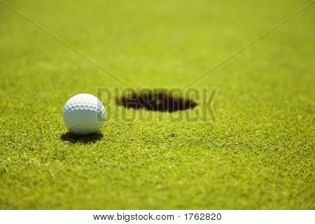 Golf club: ball close to the 18th hole poster