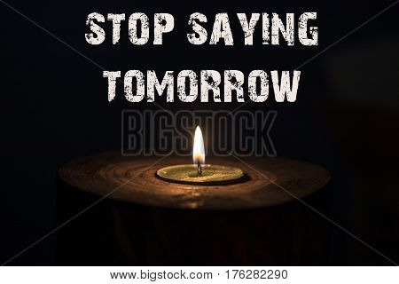 Stop Saying Tomorrow - White Candle With Dark Background - In A Wooden Candlestick