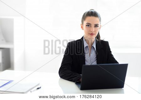 Young Beautiful Business Woman With Laptop In The Office