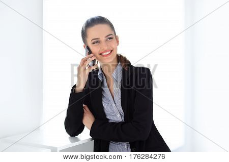 Smiling Business Woman Speaking On Mobile Phone