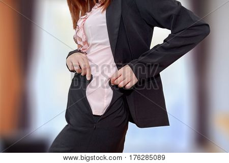 Chubby business woman cannot button up her clothes in her bed room. belly fat concept
