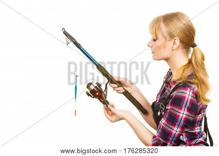 Woman In Shirt Looking At Fishing Rod