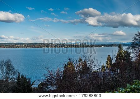 A view of the skyline of Bellevue Washington with the Cascade Mountains behind.