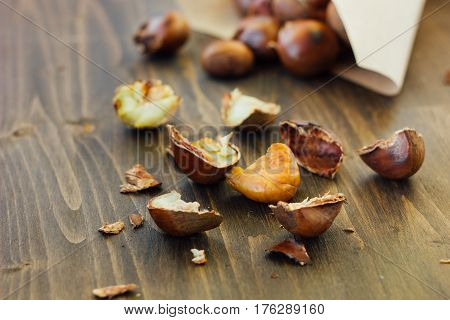 Peeled Roasted Chestnuts With Paper Cornet On Table