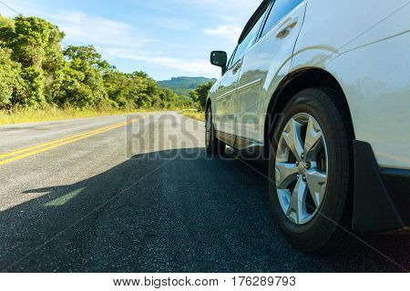Asphalt road with cars passing through the forest and mountens Landscape in summer day. Toned effect. Stock photo