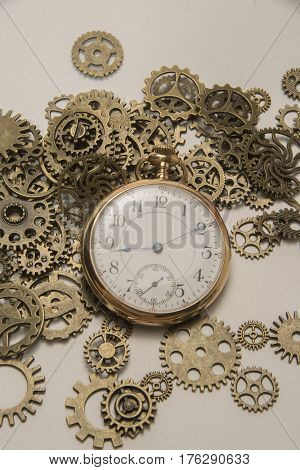 Antique mechanical gears with a old pocket watch