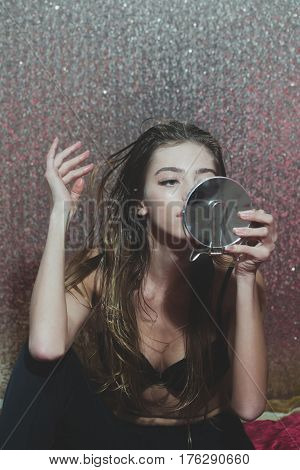 Pretty Sexy Girl Putting Glittering Mousse On Long Blond Hair