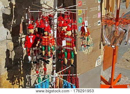 Besalu Spain - September 09 2014: Wooden pinocchio souvenirs on street market in Besalu (Catalonia Spain)