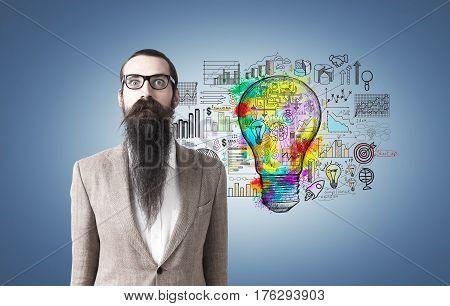 Man With Long Beard And Ligth Bulb On Blue
