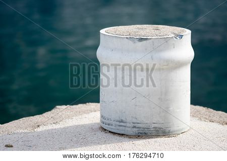 Concrete pillar for hanging ships on the shore