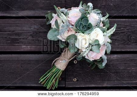 Bridal Bouquet Of Roses On A Wooden Planks
