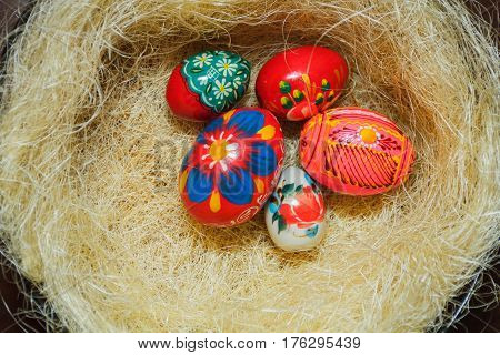 Easter eggs in the nest of sisal. Easter decorating idea for home. Closeup. holiday
