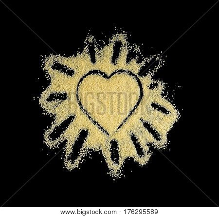 Heart made of couscous on a black background. I like couscous.