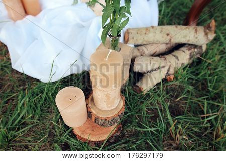 not lighted candles on logs. Wedding decoration