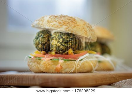 Vegetarian Fast Food - Falafel Burger On Wooden Board.