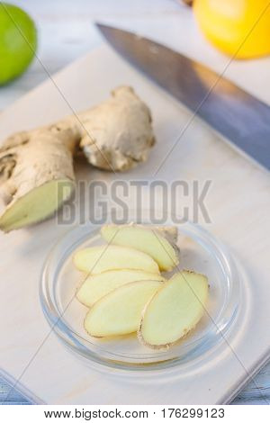 Ginger Root Slices On Transparent Glass Plate.