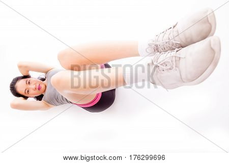 Asian Teenager Doing Situps