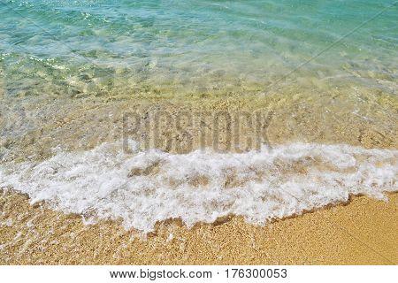 photo texture of the turquoise Aegean sea Kastraki beach Naxos Greece