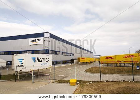 Dobroviz, Czech Republic - March 12: Dhl And Hermes Shipping Containers In Front Of Amazon Logistics