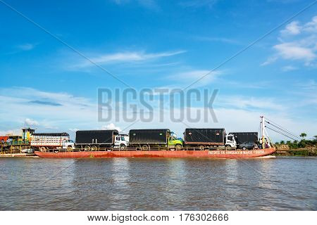 Barge Carrying Trucks Near Magangue