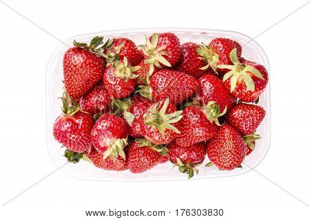 Strawberries in plastic box on a white background isolated top view