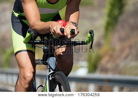 Cyclist in the race on a road bike handlebar detail