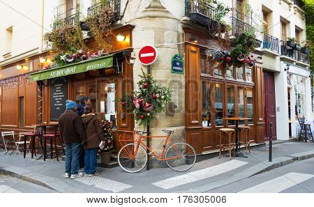 Paris, France-September 10, 2016: the traditional French cafe Au Bougnat set in a rustic bistro style, located near Notre Dame cathedral, on the isle de la Cite, in the 4th district of Paris.