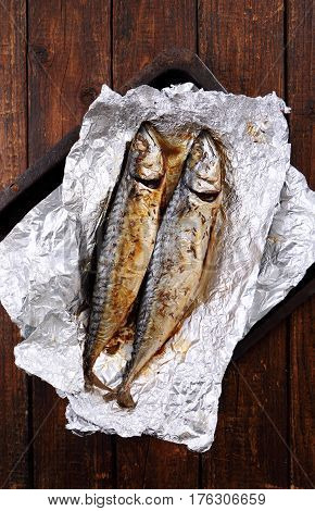 Mackerel baked in foil with spices. In the rustic style