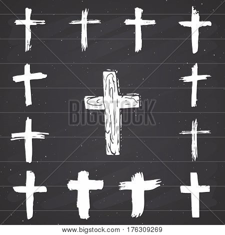 Grunge hand drawn cross symbols set. Christian crosses religious signs icons crucifix symbol vector illustration on chalkboard background