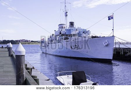 Halifax, Nova Scotia, September 23, 2015 -- Wide view of a small British gunship docked in Halifax Harbor and a bright sunny day in September in Halifax, Nova Scotia.