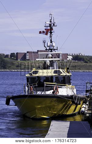 Halifax, Nova Scotia, September 23, 2015 -- Vertical view of the rescue boat called Pilot in Halifax Harbor in Halifax, Nova Scotia on a bright sunny day in September