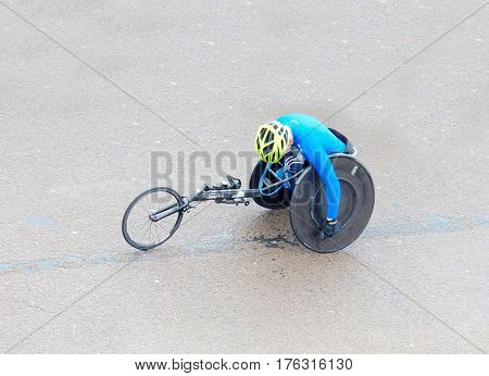 BRIGHTON GREAT BRITAIN - FEB 26 2017: Man in sports wheelchair from above in the Vitality Brighton half marathon competition. February 26 2017 in Brighton Great Britain