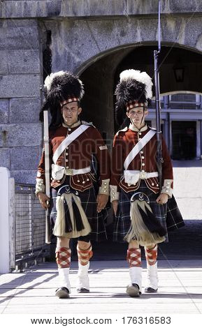 Halifax, Nova Scotia, September 23, 2015 -- Two Highlander Guards march at the entrance of the Citadel in Halifax Nova Scotia on a bright sunny day in September