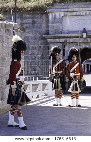 Halifax, Nova Scotia, September 23, 2015 -- Three Highlander Guards perform the changing of the guard at the Citadel in Halifax, Nova Scotia on a bright sunny day in September