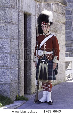 Halifax, Nova Scotia, September 23, 2015 -- A single Highlander Guard stands at attention at the entrance to the Citadel in Halifax Nova Scotia on a bright sunny day in September