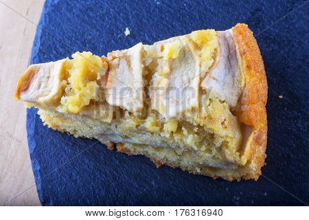 Apple Pie Slice Over Black Stone
