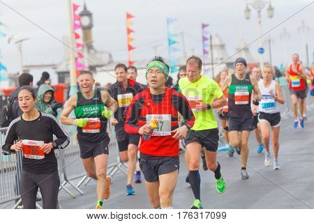 BRIGHTON GREAT BRITAIN - FEB 26 2017: Lots of male and female runners in the Vitality Brighton half marathon competition. February 26 2017 in Brighton Great Britain