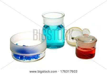 Chemical glassware weighing bottles with chemicals on white background